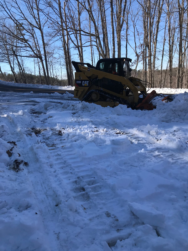 Removing snow - Stewart's Grading and Hauling
